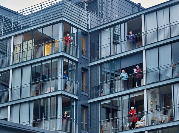 Residents on the balconies of their apartment